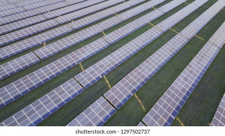 Aerial view of solar panels at sunset
