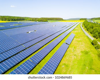 Aerial view of solar power plant. Solar farm system from above. Large photovoltaic power station. Source of ecological renewable energy.