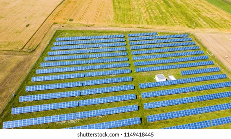 Aerial view to solar power plant. Industrial background on renewable resources theme.