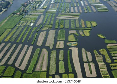 Aerial view of some green islands in the nature reserve of The 1000 Islands in Langedijk, Holland.