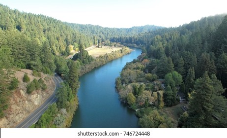 Aerial view of Sonoma County's majestic Russian River as it peacefully makes its way through the forested coastal hills. Highway 116 lies at its side.