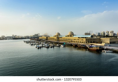 Aerial View of souq al jubail and port of sharjah with boats docked at pier