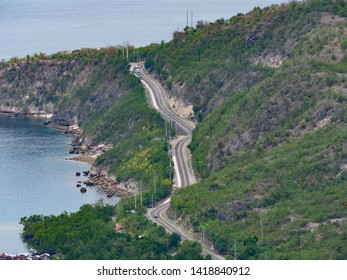 Aerial view of the South Cotabato - Sarangani Road along the coast of southern Mindanao, the southernmost large island of the Philippines.