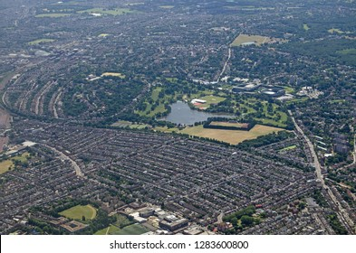 Aerial view of the South London district of Wimbledon.  In the centre of the image is the lake of Wimbledon Park, just above are the grounds of the All England Lawn Tennis Club