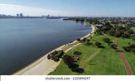 Aerial view of South Perth Western Australia along banks of Swan River showing parkland, beach and cycleway
