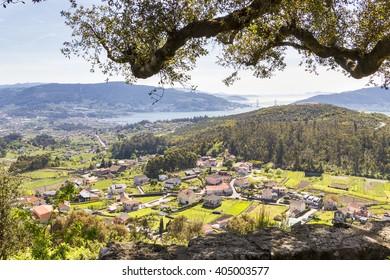 Aerial view of Soutomaior village with Vigo estuary at background