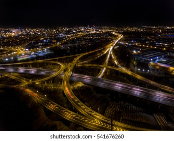Aerial view of Spaghetti Junction and Birmingham city centre at night.