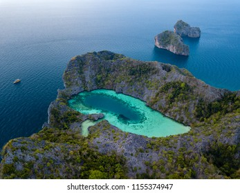 Aerial view of a spectacular shallow lagoon in the middle of a small tropical island in an archipelago