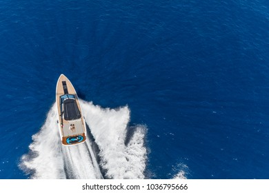 aerial view speed boat, new modern motor yacht in navigation with couple of people