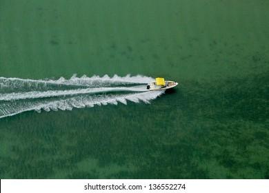 Aerial view of speeding boat on ocean