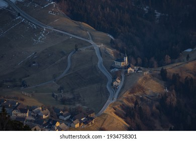 Aerial view of spodnja sorica village looking from soriska planina on late winter afternoon