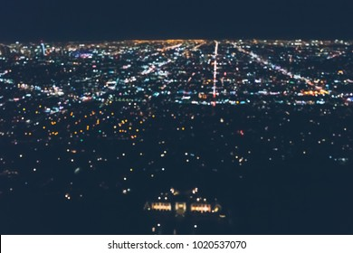 Aerial view of the sprawling Los Angeles cityscape from behind Griffith Park