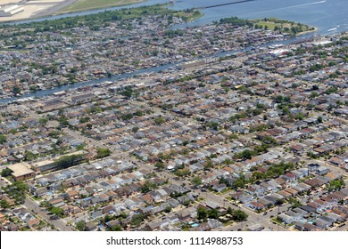 Aerial view of Sprawling suburban development with residential homes and commercial buildings