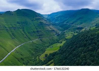 Aerial view of the spring landscape of rocks and grasslands in the Estacas de Trueba mountain pass nearby Vega de Pas village in Pasiegos valleys of Cantabria in Spain, Europe