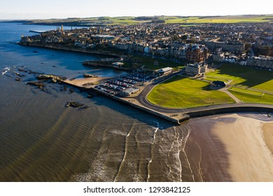Aerial view of St Andrews from West Sands. The rocky coastline and the old course of St Andrews can both be ween in this stunning photo.