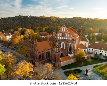 Aerial view of St. Anne's Church and neighbouring Bernardine Church, one of the most beautiful and probably the most famous buildings in Vilnius. Beautiful autumn day in the capital of Lithuania.