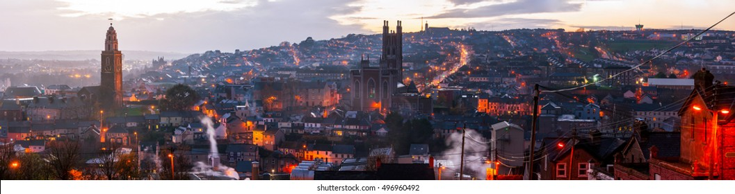 Aerial view of St. Anne's Church and Cathedral in Cork, Ireland. Mountains and sunset cloudy sky