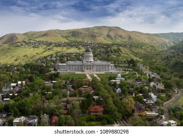 Aerial view of State Capitol building during early summer 2018 with beautiful green trees and blue sky in Salt Lake City, Utah, USA.