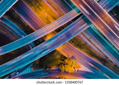 Aerial view, Static vertical top down aerial view of traffic on freeway interchange at night.