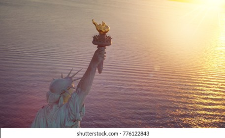 Aerial view of the Statue of Liberty at sun glare