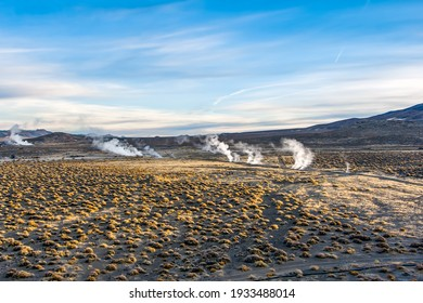 Aerial view of steam rising from geothermal vents in the Nevada desert.