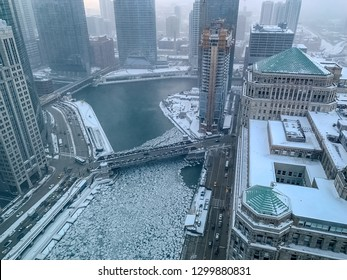 Aerial view of steamy, foggy morning over Chicago River, where chunks of ice float on frigid January morning