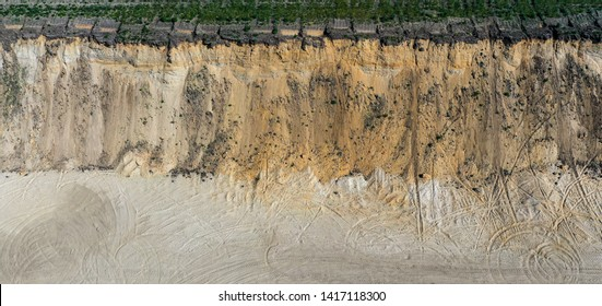 Aerial view of the steep high slope of a sand pit in Germany