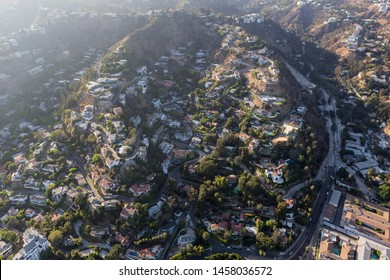 Aerial view of steep hillside homes near Laurel Canyon Blvd in the hills above West Hollywood and Los Angeles, California.