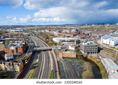 Aerial view of Stoke on Trent train station on a warm day shortly after a storm, commuter transportation system to the north and south in the midlands area of the UK