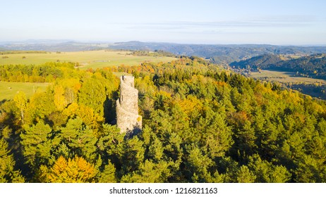Aerial view of stone lookout tower in Krasno inside forest Slavkovsky les. Beautiful tourist landmark and nature landscape from drone view. West bohemia in Czech republic.