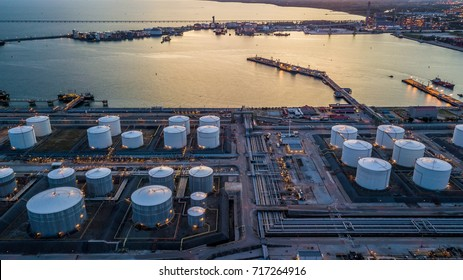 Aerial view storage tank farm at night, Tank farm storage chemical petroleum petrochemical refinery product at oil terminal, Business commercial trade fuel and energy transport by tanker vessel.