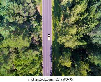 Aerial view of straight road through the mixed forest, Mazury, Poland