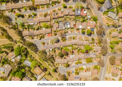 Aerial view of streets, cul-de-sacs, rooftops and parklands in the suburb of Latham in Canberra, the Capital of Australia