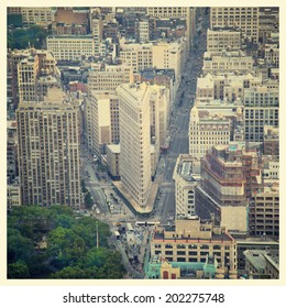 Aerial view of the streets of New York City including the Flatiron building with instagram style filter
