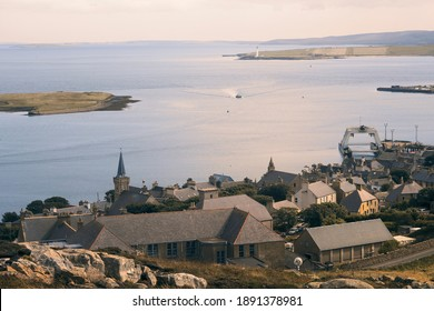 Aerial view of Stromness and Scapa Flow on Orkney islands with small fishing boat - Shutterstock ID 1891378981