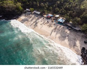 Aerial view of the stunning Bias Tugel Beach, a hidden tranquil beach near Padang Bai in Northeast Bali in Indonesia