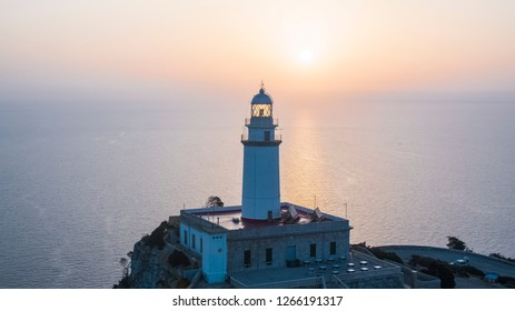 Aerial view of the stunning, Cap de Formentor lighthouse during sunrise hours in Mallorca, Spain. Showing a beautiful lighthouse, watchtower, view point in the mountains.