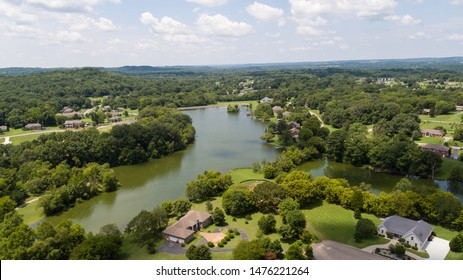 Aerial View Of Subdivision On Lake With Lakefront Homes