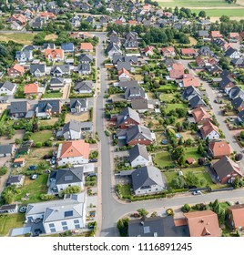 Aerial view of a suburb with detached houses, semi-detached houses and terraced houses with small front gardens and green lawns in northern Germany, traditional settlement