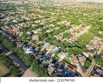 Aerial view suburb growing outside Dallas downtown in Irving, Texas, USA. Bird eye green architecture in new subdivision development of tightly packed homes with driveways, vast neighborhood suburbia
