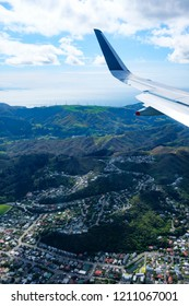 Aerial view of the suburb of Karori, Wellington with Makara wind farm in the background