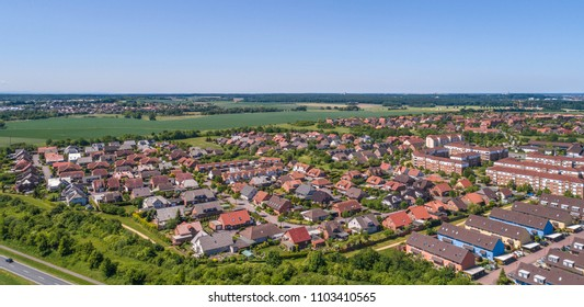 Aerial view of a suburb on the outskirts of Wolfsburg in Germany, with terraced houses, semi-detached houses and detached houses, made with drone