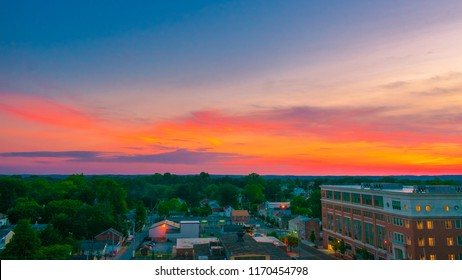 Aerial view of suburban houses and colorful sunset sky - West Chester, Pennsylvania, USA