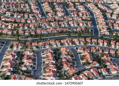 Aerial view of suburban Los Angeles cul-de-sac streets and homes in the San Fernando Valley region of Southern California.