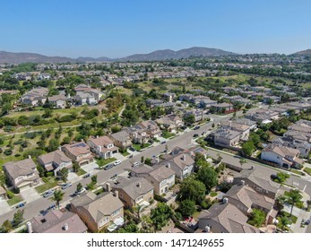 Aerial view suburban neighborhood with  big villas next to each other in Black Mountain, San Diego, California, USA. Aerial view of residential modern subdivision luxury house. - Shutterstock ID 1471249655