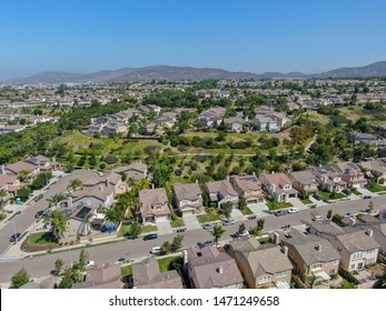 Aerial view suburban neighborhood with  big villas next to each other in Black Mountain, San Diego, California, USA. Aerial view of residential modern subdivision luxury house.