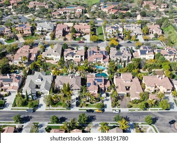 Aerial view suburban neighborhood with identical wealthy villas next to each other. San Diego, California, USA. Aerial view of residential modern subdivision luxury house with swimming pool.