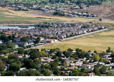 Aerial view of suburban neighborhoods as developments sprawl out into surrounding open areas in Reno, Nevada, USA.