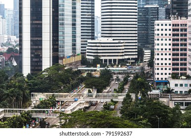 Aerial view of the Sudirman avenue in the heart of Jakarta business district with the foot bridge to link the Transjakarta bus shelter in the middle of the road. Jakarta is Indonesia capital city.