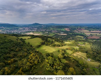 An aerial view of the Sugar Loaf mountain and farm land in Monmouthshire, Abergavenny, Wales